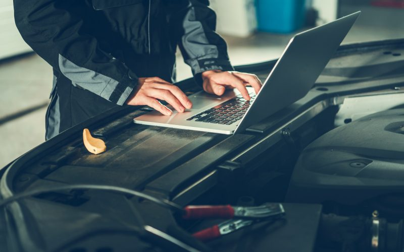 Car Mechanic with Computer