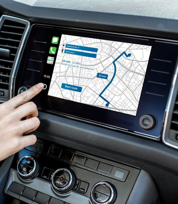 Woman using navigation in the car